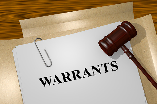 An arrest warrant and gavel